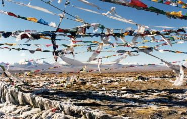 Prayer flags adorn the landscape in Tibet